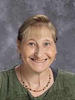 Charles City High School teacher with COVID-19 dies